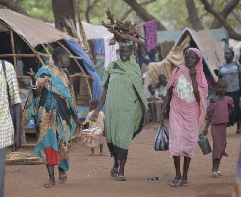 Women walk through a camp for more than 12,000 internally displaced persons in Wau, South Sudan.