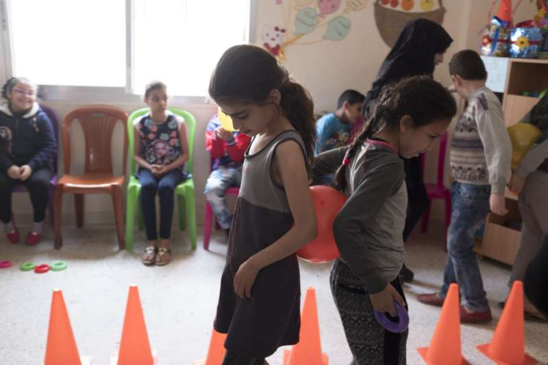Children in the 'Palestine Flower' class take part in an activity about collaboration, communication and trust.