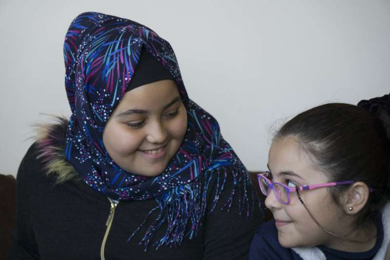 Joud Al Khairat, 10 and her sister Hala, 7, fled Syria with their family. Together they attend art classes at the centre.
