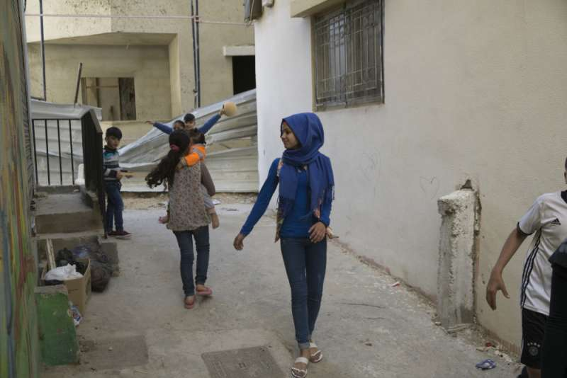 child refugees playing in Nahr al-Bared camp