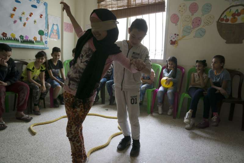 Nine-year-old Hassan Hamoudeh takes part in a trust-building game at the centre.