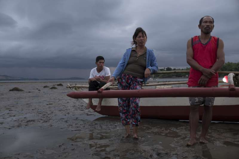 Mary Ann, Jose and son by fishing boat