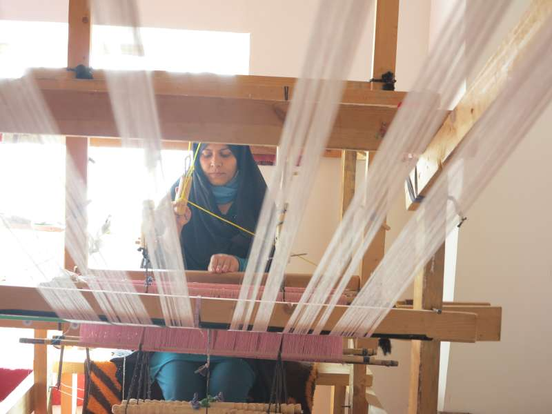 Afghan woman silk- weaving