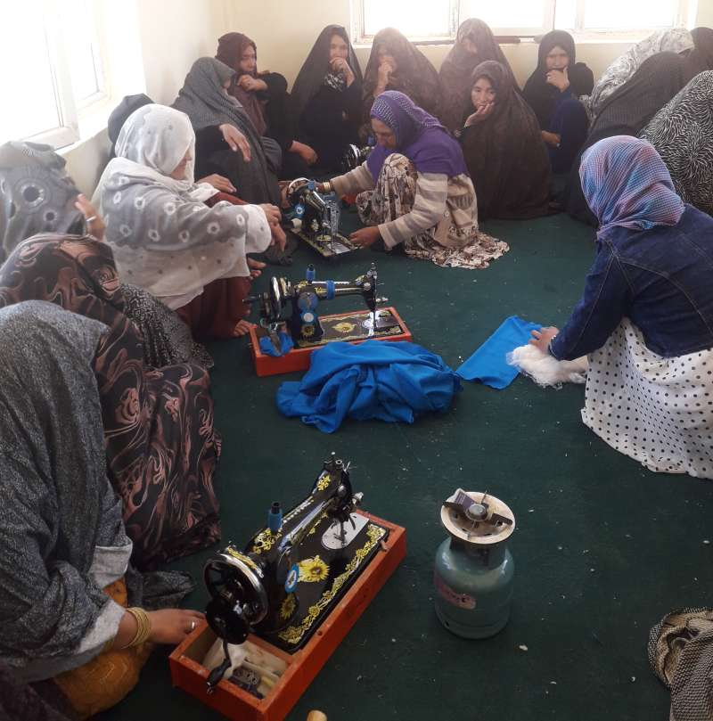 Afghan women making sanitary products