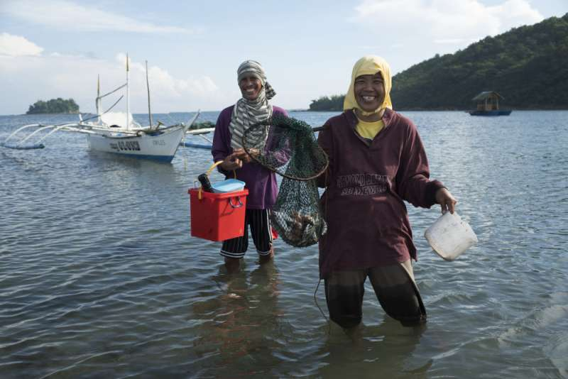 Lope and Eva return from fishing with their catch