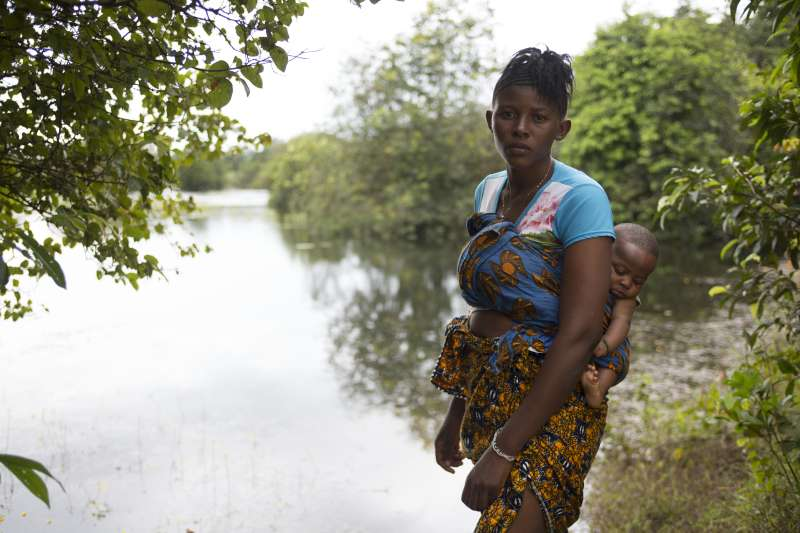 Tenneh and her baby by the stream - Christian Aid