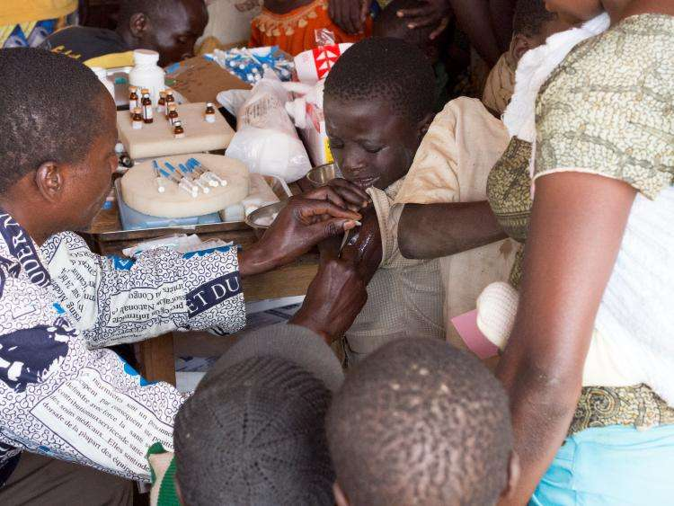 A child being immunised in the DRC