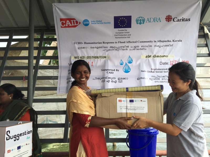 Aid being handed over at a distribution point in Kerala