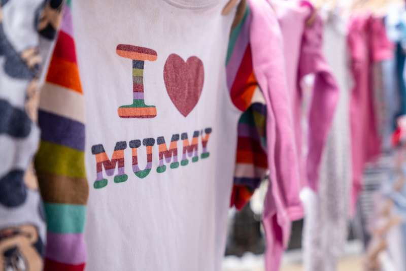 Pre-loved baby grows are displayed as a symbol of solidarity with mums in Sierra Leone.