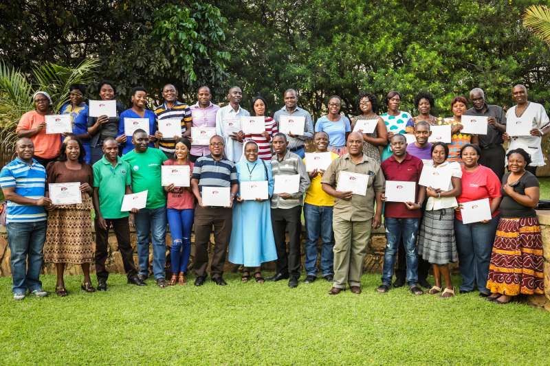 Farmers stand with their certificates for gender and equality training in Zambia, which was led by Sheila Murimoga from Christian Aid