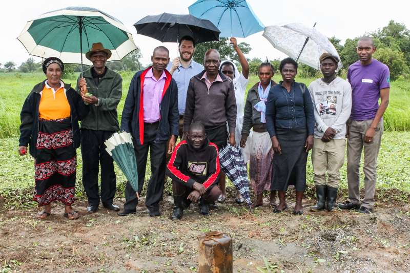 Group photo after inspecting the borehole site, Mpunde, Central Province, Zambia. The inspection team included Craig Smith from the Scottish Government; and Chilewe Siakasiya from Christian Aid partner CHAZ.