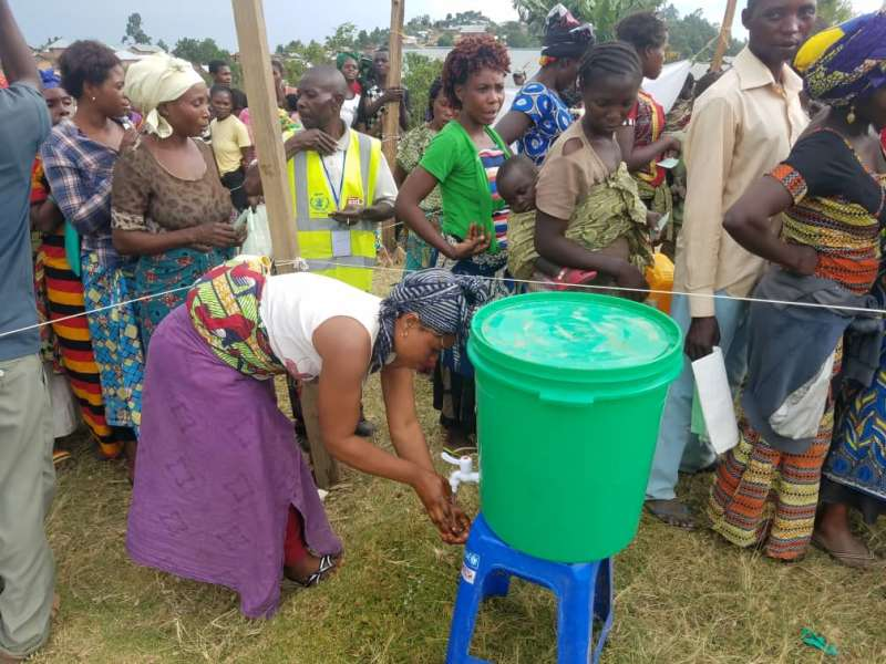 Lessons on hygiene and the need to wash hands being given to those receiving food rations in South Lubero.