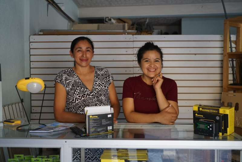 In their shop, Ana and her colleagues sell a variety of sustainable energy products, including lamps and radios