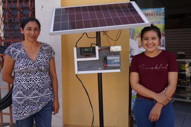 Ana Moradel and her business partner, outside their new business selling sustainable energy products