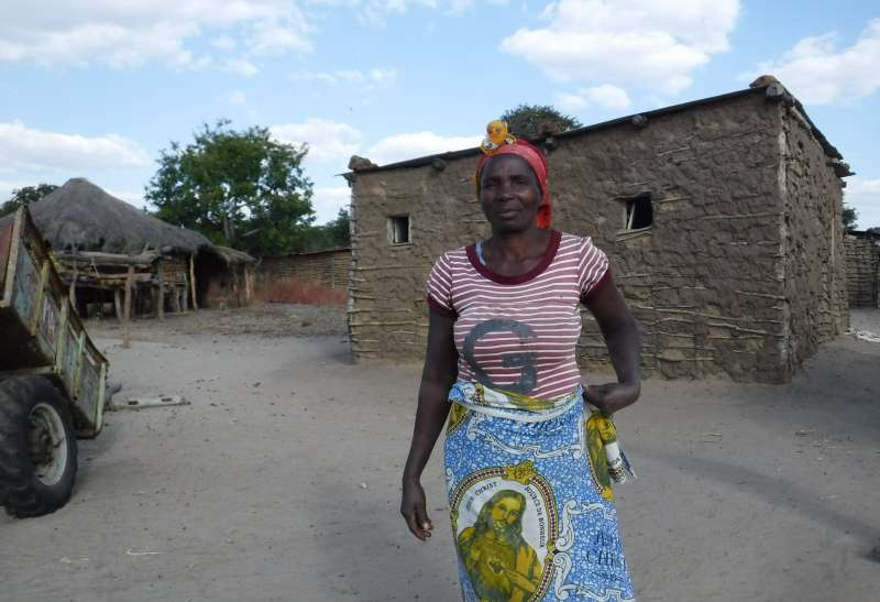 Filomena Njanga from Mavinga outside her house