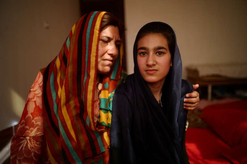 Aneesa, who was helped through the ITL project, sits at home with her mother