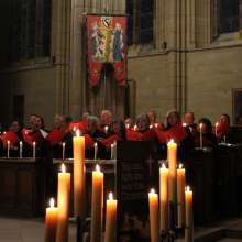 A choir singing in candlelight at Lancing College Chapel