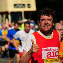 Andrew, a Christian Aid runner, gives a thumbs up to the camera at the Great North Run 2015