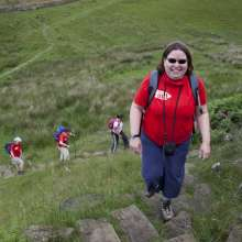 A Christian Aid fundraiser taking part in the Hadrian's Wall Trek