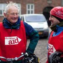 Two Christian Aid supporters wearing branded bibs on the London to Copenhagen cycle