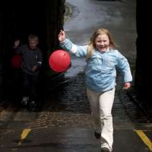 A girl with a balloon on a sponsored walk in Berwick upon Tweed