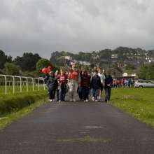Chrisitan Aid supporters at a sponsored walk in Newton Abbot racecourse