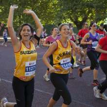Suzanne and Rebecca, Christian Aid runners, running together at the Royal Parks Half Marathon