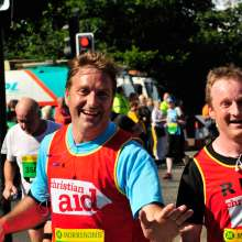 Two male runners at the Great North Run 2015