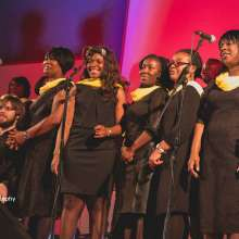 Choir on stage. Copyright Aris Asula Photography