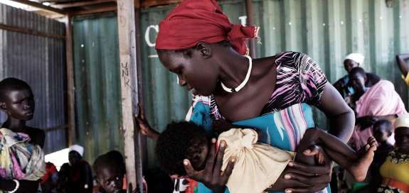 Nyayiah Maker and her six-month-old son Nya Ban Nyieny at Duong Health Clinic outside Nyal, South Sudan