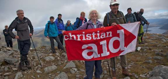 Climbers with Christian Aid banner