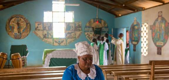 Florence Muthiani says a prayer inside her church.