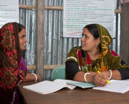 Two women having a meeting in a Bangladesh office