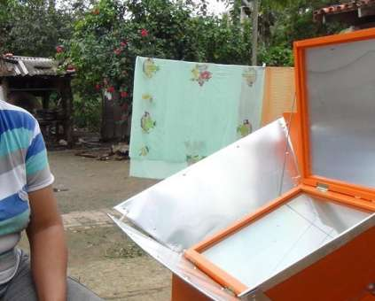 Esther Guarayuco's family was one of the first to receive a solar oven in the Bolivian Amazon. The Caring for Mother Earth project has now delivered 260 ovens to 20 communities in the region.