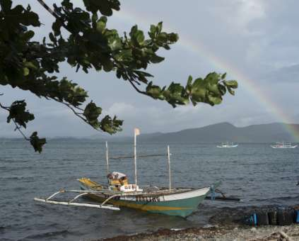 Seaweed farmers on Polopina island, Philippines, with rainbow in the background. As featured in our Lent and Easter appeal.