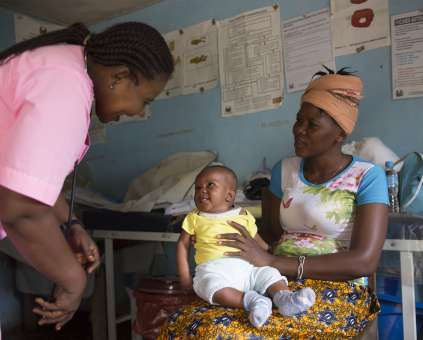 Tenneh and her baby have a check-up with Nurse Judith - Christian Aid