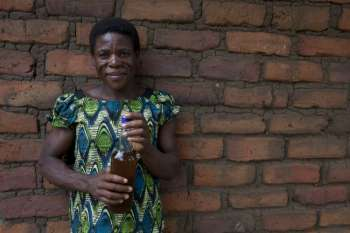 A woman in Malawi who makes her own banana wine to sell