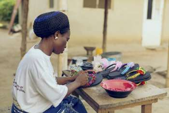 The project trained Amina in bead making and taught her how to produce necklaces, bracelets, earrings and slippers