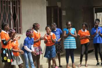 Girls enjoying a music and movement activity at the Girls Building Bridges project.