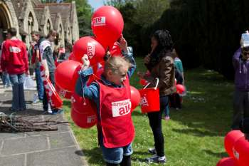 Girl fundraising for Christian Aid Week
