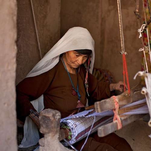 Afghanistan woman weaving