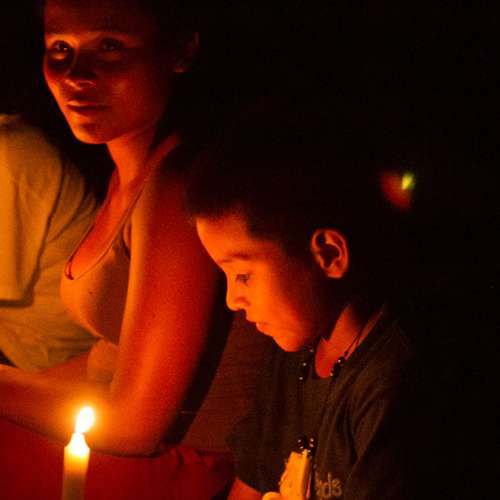 Colombian children with candles