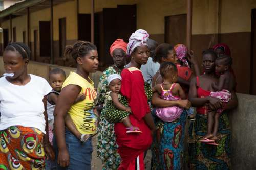 Women with babies queue at health clinic