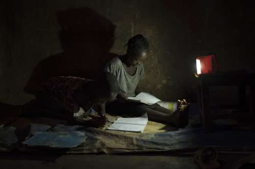 Solar lamps have replaced firewood as the key energy source for lighting the home. Children can now study in the evening in a smokeless environment, Alduba village, Ethiopia.