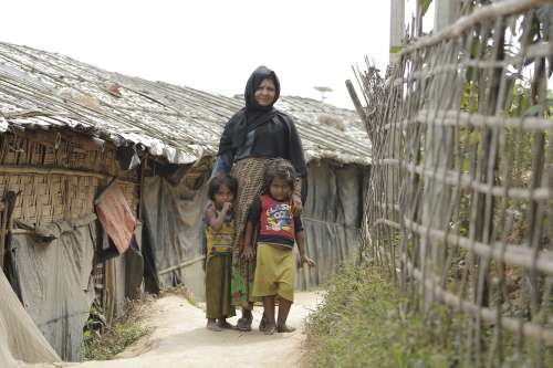Mother with children inside Rohingya camp