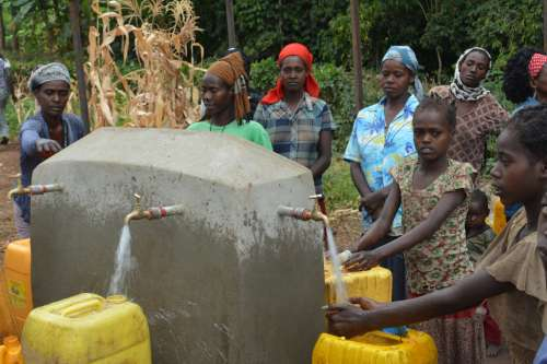 Children getting clean water from water point