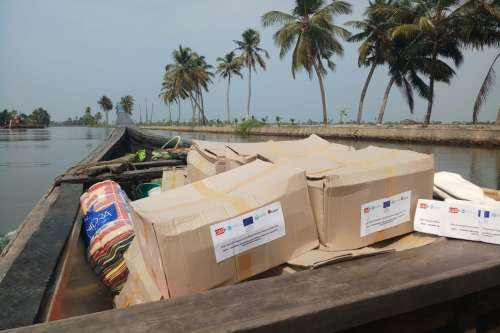 Aid being transported by boat to flood-affected communities in Kerala