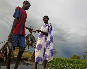 A woman buying some fish, South Sudan