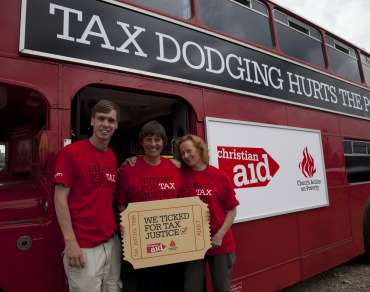 Intern Andrew Forsyth and Christian Aid staff Judith Sadler and Kerry Crellin by the Tax Justice bus
