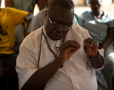 Faith leader Father Peter Conteh
